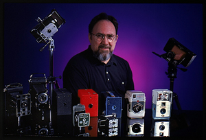 Ken Riley among his camera collectibles